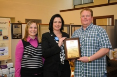 Community relations director Nicole A. Barber (far left) from The Greater Scranton Chamber of Commerce recently honored Bear Owen Paving Company owner Thomas Owen, Jr. for his entrepreneurial spirit and contributions to the local community. Theresa Collins of First Liberty Bank and Trust's Olyphant branch presented the award.